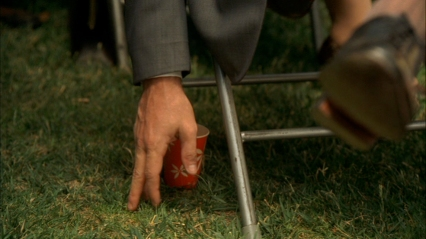 mad men don draper hand in grass