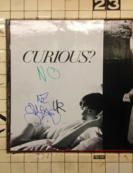 fifty shades of grey poster nyc subway graffiti