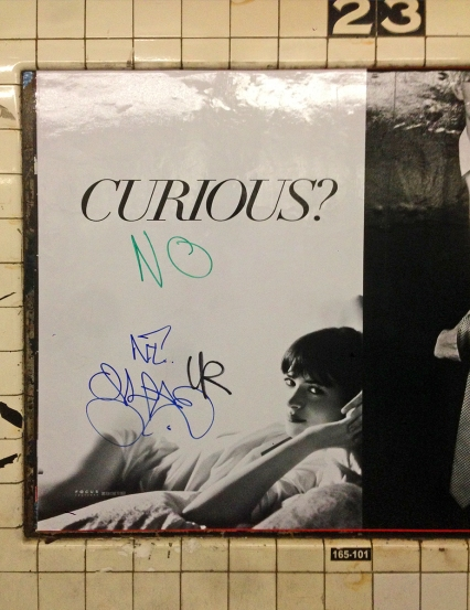fifty shades of grey poster nyc subway graffiti